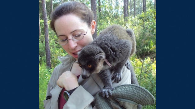 Associate Professor Francine Dolins with a common brown lemur