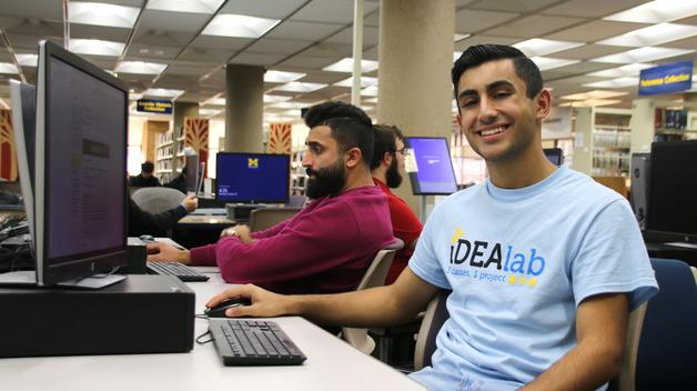 UM-Dearborn student Ali Almehdi doing research on a computer in the Mardigian Library.