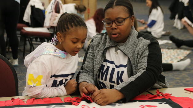 More than 400 people — faculty, staff, students and community members — came together to volunteer for the campus' annual MLK Day of Service. Volunteer activities included making fleece blankets for use at the Dearborn Animal Shelter.