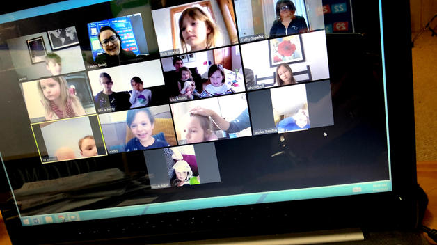 A laptop screen displaying  kindergartners logged in for a virtual class via Zoom