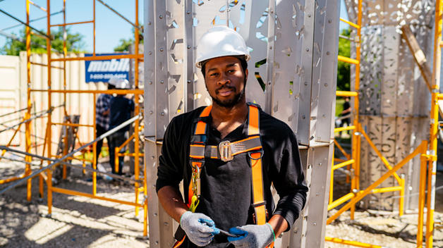 Keviyan Richardson works on site during the American Riad canopy installation.