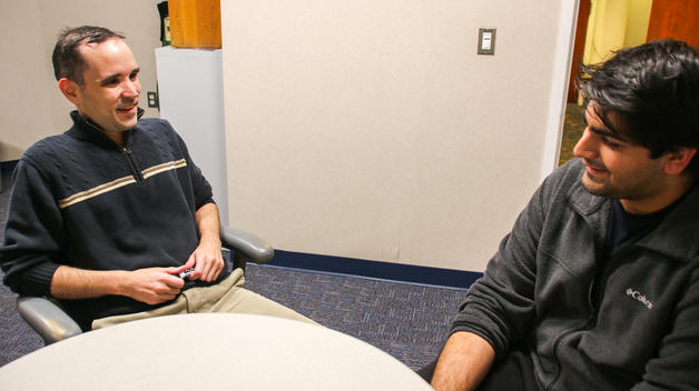 Assistant Professor Michael Killey talks taxes with Accounting and Finance major Daniel Pandit.