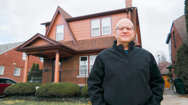 UM-Dearborn Political Science Professor Dale Thomson in front of his home in Northwest Detroit.