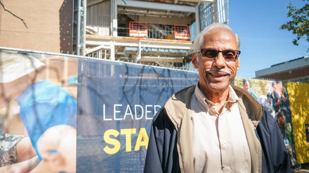 Professor Emeritus Malayappan Shridhar standing in front of the new Engineering Lab Building