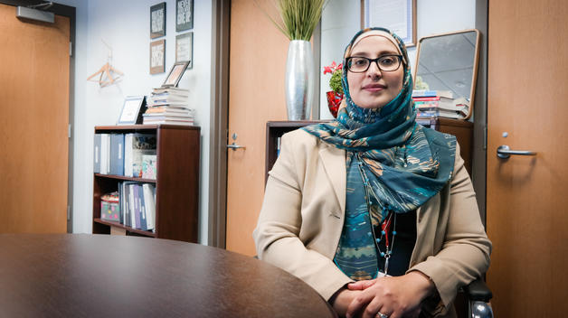 UM-Dearborn alumna and Hamtramck Public Schools superintendent Jaleelah Ahmed sitting in her office