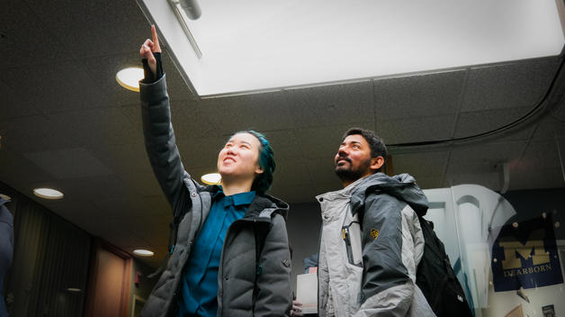 CECS grad students Christine Li (right) and Viraj Tulaskar inspect a skylight in the Administration Building.