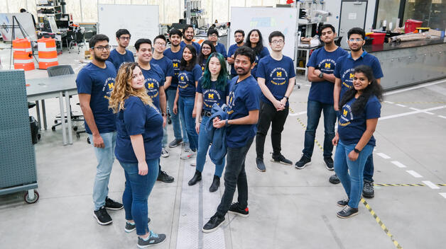 The 19 graduate students who participated in the E-Challenge competition pose for a photo in the IAVS high bay.