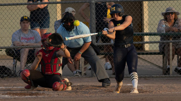 Madelin Skene hits the softball during a game.
