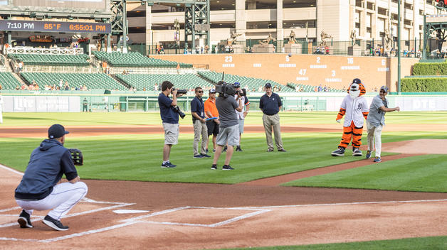 Chancellor Domenico Grasso throws out the first pitch at UM-Dearborn Night at Comerica Park.