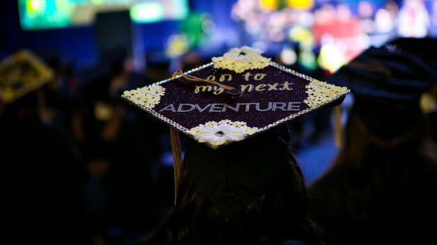 "Photo of graduation mortar board that says ""On to the next adventure"""